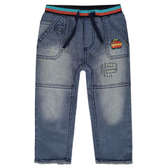 Used and crinkled-effect jeans with hot dog badge and decorative worn details