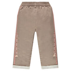 Pants in an original cotton fabric with embroidery and pompoms
