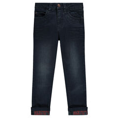 Worn and crinkled-effect, slim-cut jeans with textured writing