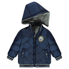 Reversible letterman jacket with a removable hood