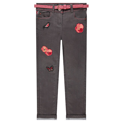 Slim jeans with sparkly belt and embroidered badges