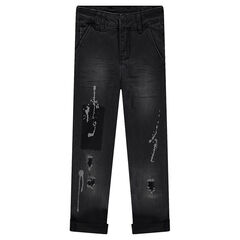 Used and crinkled-effect jeans with worn details and paint stains