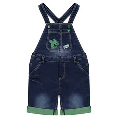 Short overalls in distressed denim with embroidered pattern