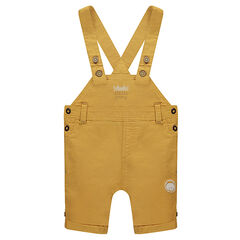 Short canvas overalls with a lion patch