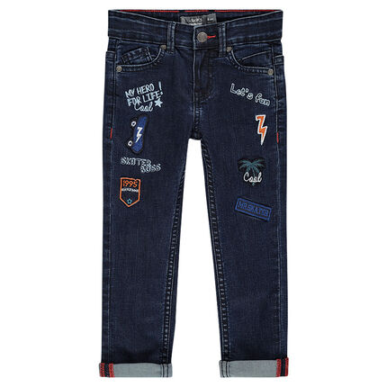 Slim-cut jeans with patched badges and decorative prints