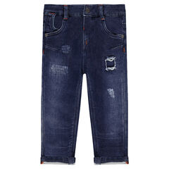 Distressed fleece jeans with decorative worn details