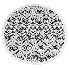 Round beach towel with an ethnic motif and fringes