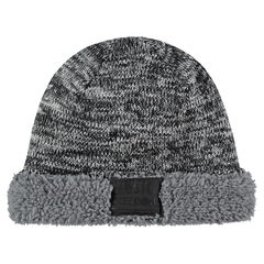 Twisted knit cap with sherpa lining and badge