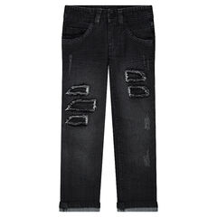 Distressed slim fit jeans with decorative worn details