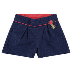 Semi-plain shorts with fringed badge and hints of red