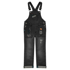 Distressed denim overalls with emblem-style badge patches