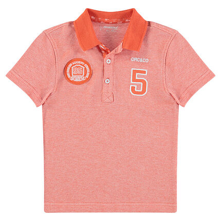 Short-sleeved piqué cotton polo shirt with patched badges