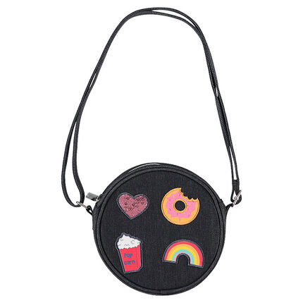 Denim-effect round shoulder bag with trendy badges