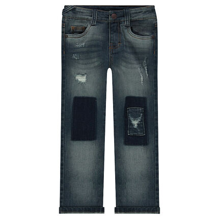 Used and crinkled-effect jeans with shadows and rips