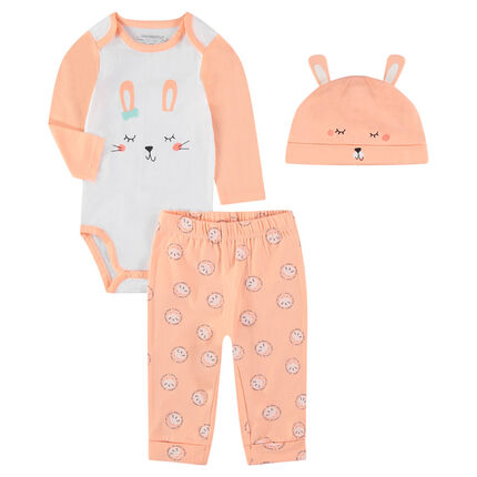 Newborn ensemble with a pajama bodysuit and beanie featuring a rabbit print