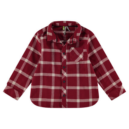Long-sleeved checkered flannel shirt.