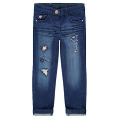 Used and crinkled-effect jeans with embroidered motifs on the legs