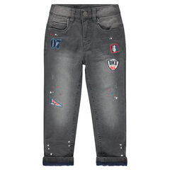 Microfleece-lined used-effect jeans with paint stains and badges