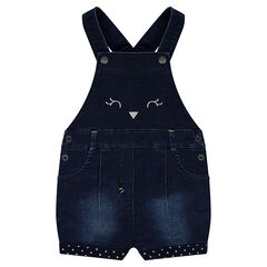 Distressed short denim overalls with polka-dotted lining