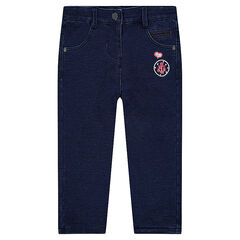 Used-effect fleece jeans with embroidered badges