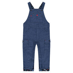 Overalls in an original cotton fabric with snap-fastened pockets