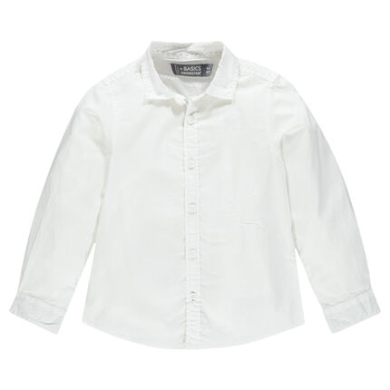 Long-sleeved, plain-colored cotton shirt.