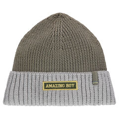 Knit cap with an embroidered badge