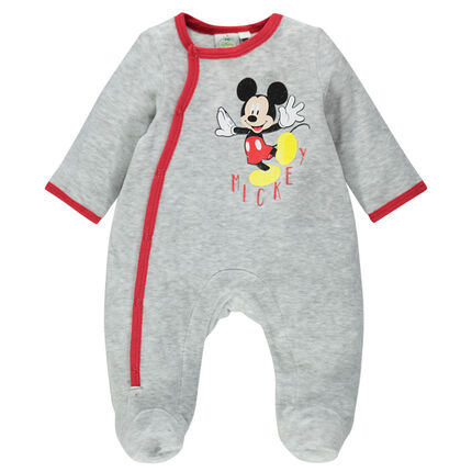 Velvet footed sleeper with a Disney Mickey Mouse print and opening adapted according to the age