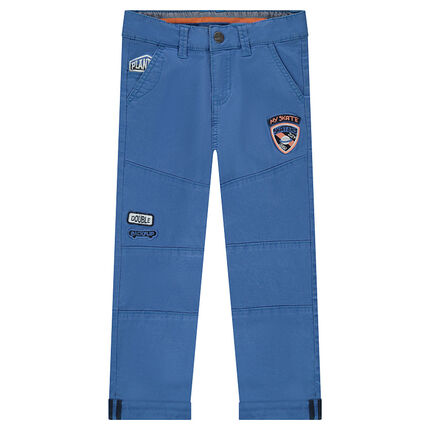 Plain blue pants with badge patches