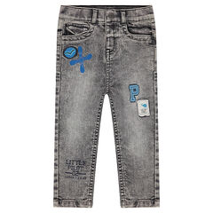 Used snow wash-effect jeans with badges and prints