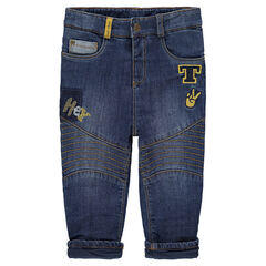 Used-effect, sherpa-lined jeans with embroidered details and badge patches