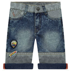 Bermuda shorts in distressed denim with patches