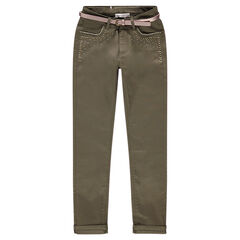 Khaki slim fit pants with studs and an iridescent belt