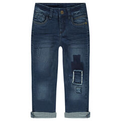 Crinkled-effect jeans with used-effect patches