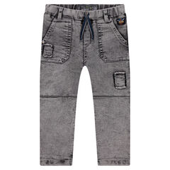 Snow wash-effect jeans with a viking badge and distressed patches
