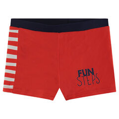 Red beach shorts with a printed message